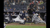 Tampa Bay Rays' Joey Wendle, right, slides past New York Yankees catcher Gary Sanchez to score on a Travis d'Arnaud double during the seventh inning of a baseball game Tuesday, June 18, 2019, in New York. (AP Photo/Frank Franklin II)