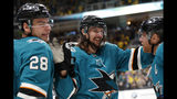 FILE - In this Feb. 16, 2019, file photo, San Jose Sharks' Erik Karlsson, center, celebrates with Timo Meier, left, and Joe Pavelski after Pavelski scored during the third period of an NHL hockey game against the Vancouver Canuck, in San Jose, Calif. The San Jose Sharks re-signed pending free agent Erik Karlsson to an eight-year deal on Monday, June 17, 2019, turning a one-year rental into a long-term commitment to one of the league's most dynamic defensemen.(AP Photo/Josie Lepe, File)