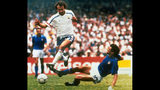 """FILE - In this file photo dated June 17, 1986, Michel Platini, left, of France dribbles past Italian forward Alessandro Altobelli in their World Cup eight finals in Mexico City's Azteca Stadium. France won 2-0 to advance to the quarterfinals of the tournament and Italy was eliminated. Affectionately nicknamed """"Le Roi"""" (The King), Michel Platini bestrode the soccer field with inimitable elegance as the world's best player of the early 1980s, but his lofty reputation seems to have been tainted. (AP Photo, FILE)"""