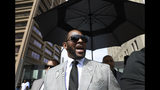 Musician R. Kelly departs the Leighton Criminal Court building after pleading not guilty to 11 additional sex-related charges, Thursday, June 6, 2019, in Chicago. (AP Photo/Amr Alfiky)