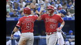 Los Angeles Angels center fielder Mike Trout (27) celebrates his two run homer against Toronto Blue Jays starting pitcher Aaron Sanchez with teammate Tommy La Stella (9), who scored on the play, during the second inning of a baseball game, Wednesday, June 19, 2019 in Toronto. (Nathan Denette/Canadian Press via AP)