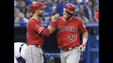Los Angeles Angels center fielder Mike Trout (27) celebrates with Jonathan Lucroy after hitting a grand slam off of Toronto Blue Jays starting pitcher Aaron Sanchez during the fourth inning of a baseball game, Wednesday, June 19, 2019 in Toronto. (Nathan Denette/Canadian Press via AP)