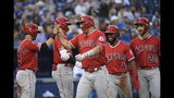 Los Angeles Angels center fielder Mike Trout (27) celebrates with teammates after hitting a grand slam off of Toronto Blue Jays starting pitcher Aaron Sanchez during the fourth inning of a baseball game, Wednesday, June 19, 2019 in Toronto. (Nathan Denette/Canadian Press via AP)