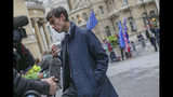 British Conservative Party leadership contender Rory Stewart talks to the media as he arrives for a live TV debate in central London Tuesday, June 18, 2019. Britain's Conservative Party will continue to hold elimination votes until the final two contenders will be put to a vote of party members nationwide, with the winner due to replace Prime Minister Theresa May as party leader and prime minister.(AP Photo/Vudi Xhymshiti)