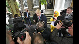 Britain's Conservative Party leadership contender Boris Johnson leaves his home in south London, Wednesday June 19, 2019. Former Foreign Secretary Boris Johnson increased his lead in the race to become Britain's next prime minister Tuesday in a Conservative Party vote that eliminated one of his rivals and enabled upstart candidate Rory Stewart to defy expectations by remaining in the contest. (Dominic Lipinski/PA via AP)