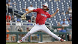 Louisville pitcher Adam Elliott (4) works against Auburn in the sixth inning of an NCAA College World Series baseball game in Omaha, Neb., Wednesday, June 19, 2019. (AP Photo/Nati Harnik)