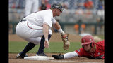 Louisville's Adam Elliott, right, slides back to first base on a pickoff attempt by Auburn first baseman Rankin Woley in the seventh inning of an NCAA College World Series baseball game in Omaha, Neb., Wednesday, June 19, 2019. (AP Photo/Nati Harnik)