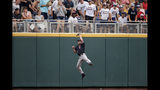 Texas Tech center fielder Dylan Neuse (9) makes a catch at the wall of a ball hit by Florida State's Cole Sands (26), in the first inning of an NCAA College World Series baseball game in Omaha, Neb., Wednesday, June 19, 2019. (AP Photo/Nati Harnik)