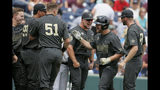 Vanderbilt's Stephen Scott second right, is greeted at the dugout after hitting a solo home run against Mississippi State in the second inning of an NCAA College World Series baseball game in Omaha, Neb., Wednesday, June 19, 2019. (AP Photo/Nati Harnik)