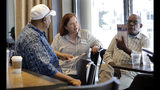 In this photo taken Monday, June 10, 2019, Seattle City Council candidate Pat Murakami, center, talks with voters in a coffee shop about her campaign in Seattle. A first-of-its-kind public campaign finance program in Seattle gives voters vouchers worth $100 to pass on to any candidate they want. Now in its second election cycle, advocates say the program can level the political playing field, although its first round in Seattle showed mixed results. (AP Photo/Elaine Thompson)
