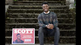 In this photo taken Monday, June 10, 2019, Seattle City Council candidate Shaun Scott, who describes himself as a democratic socialist, poses for a photo in Seattle. A first-of-its-kind public campaign finance program in Seattle gives voters vouchers worth $100 to pass on to any candidate they want. Now in its second election cycle, advocates say the program can level the political playing field, although its first round in Seattle showed mixed results. (AP Photo/Elaine Thompson)