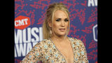 "FILE- In this June 6, 2019 file photo, Carrie Underwood arrives at the CMT Music Awards at the Bridgestone Arena in Nashville, Tenn. On Wednesday, June 19, 2019, a songwriting team filed a lawsuit against the singer, the NFL and NBC, saying they stole a song and used it to introduce ""Sunday Night Football"" during the 2018-2019 season. (AP Photo/Sanford Myers, File)"