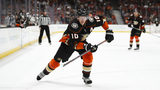 """FILE - In this March 18, 2018, file photo, Anaheim Ducks' Corey Perry skates during the second period of an NHL hockey game against the New Jersey Devils, in Anaheim, Calif. The Anaheim Ducks have bought out the contract of former NHL MVP Corey Perry after 14 seasons with the franchise. The Ducks announced the move Wednesday, June 19, 2019. General manager Bob Murray called it """"one of the most difficult decisions I've had to make in my 44 years in the NHL.""""(AP Photo/Jae C. Hong, File)"""