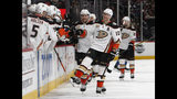 """FILE - In this March 15, 2019, file photo, Anaheim Ducks right wing Corey Perry, right, is congratulated as he passes the team box after scoring the go-ahead goal against the Colorado Avalanche during the third period of an NHL hockey game, in Denver. The Anaheim Ducks have bought out the contract of former NHL MVP Corey Perry after 14 seasons with the franchise. The Ducks announced the move Wednesday, June 19, 2019. General manager Bob Murray called it """"one of the most difficult decisions I've had to make in my 44 years in the NHL."""" (AP Photo/David Zalubowski, File)"""