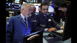 FILE - In this June 11, 2019, file photo trader Timothy Nick, left, and specialist Dilip Patel work on the floor of the New York Stock Exchange. The U.S. stock market opens at 9:30 a.m. EDT on Wednesday, June 19. (AP Photo/Richard Drew, File)