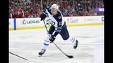 "FILE - In this March 10, 2019, file photo, Winnipeg Jets right wing Kevin Hayes (12) shoots the puck during the second period of an NHL hockey game against the Washington Capitals, in Washington. The Philadelphia Flyers have signed center Kevin Hayes to a $50 million, seven-year contract that's worth $7.14 million per season. Hayes should step in as the Flyers' new No. 2 center behind Sean Couturier. General manager Chuck Fletcher announced the deal Wednesday, June 19, 2019, file photo, saying the 6-foot-5, 216-pound Hayes ""plays a smart, two-way game and is just entering the prime of his career."" Philadelphia acquired Hayes' negotiating rights from Winnipeg for a fifth-round pick during the Stanley Cup Final. (AP Photo/Nick Wass, File)"