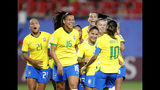 Brazil's Marta, front right, celebrates with teammates after scoring her side's first goal during the Women's World Cup Group C soccer match between Italy and Brazil at the Stade du Hainaut in Valenciennes, France, Tuesday, June 18, 2019. (AP Photo/Michel Spingler)