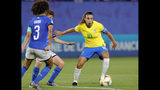 Brazil's Marta, right, duels for the ball during the Women's World Cup Group C soccer match between Italy and Brazil at the Stade du Hainaut in Valenciennes, France, Tuesday, June 18, 2019. (AP Photo/Michel Spingler)
