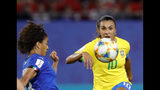 Italy's Sara Gama, left, tries to block a shot from Brazil's Marta during the Women's World Cup Group C soccer match between Italy and Brazil at the Stade du Hainaut in Valenciennes, France, Tuesday, June 18, 2019. (AP Photo/Michel Spingler)