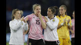 Scotland's Jane Ross, right, comforts teammate Sophie Howard, center, at the end of the Women's World Cup Group D soccer match between Scotland and Argentina at Parc des Princes in Paris, France, Wednesday, June 19, 2019. The match ended in a 3-3 draw. (AP Photo/Alessandra Tarantino)