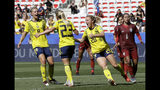 Sweden's Mimmi Larsson, front right, Sweden's scorer Elin Rubensson, front center, and Sweden's Lina Hurtig, left, celebrate their side's fifth goal during the Women's World Cup Group F soccer match between Sweden and Thailand at the Stade de Nice in Nice, France, Sunday, June 16, 2019. Sweden defeated Thailand by 5-1.(AP Photo/Claude Paris)