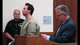 FILE - In this June 5, 2019 file photo former critical care doctor William Husel, center, pleads not guilty to murder charges while appearing with defense attorney Richard Blake, right, in Franklin County Court in Columbus, Ohio. An Ohio hospital system has reached nearly $4.5 million in settlements so far over the deaths of patients who allegedly received excessive painkiller doses ordered by Husel, now charged with murder. Over two dozen wrongful-death lawsuits have been filed against the Columbus-area Mount Carmel Health System and now-fired intensive care doctor William Husel. (AP Photo/Kantele Franko)