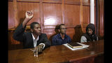 From left to right, defendants Rashid Charles Mberesero, Hassan Aden Hassan and Mohamed Abdi Abikar, sit in the dock to hear their verdict at a court in Nairobi, Kenya Wednesday, June 19, 2019. The Kenyan court found Mberesero, Hassan and Abikar guilty of conspiracy to commit a terror attack after phone records and handwriting linked them to the 2015 Garissa University assault that killed 148 people, while a fourth person, Sahal Diriye Hussein, was acquitted. (AP Photo/Khalil Senosi)