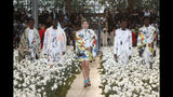 Model Gigi Hadid, centre, wears a creation for the Off White mens Spring-Summer 2020 fashion collection presented in Paris, Wednesday, June 19. (AP Photo/Thibault Camus)