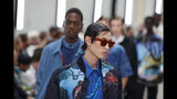 Models wear creations for the Valentino mens Spring-Summer 2020 fashion collection presented in Paris, Wednesday, June 19. (AP Photo/Francois Mori)