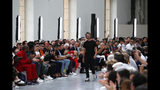 Designer Pier Paolo Piccioli accepts applause at the end of the Valentino mens Spring-Summer 2020 fashion collection presented in Paris, Wednesday, June 19. (AP Photo/Francois Mori)