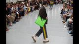 A model wears a creation for the Valentino mens Spring-Summer 2020 fashion collection presented in Paris, Wednesday, June 19. (AP Photo/Francois Mori)