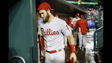 Philadelphia Phillies' Bryce Harper walks out of the dugout after the second baseball game of a doubleheader against the Washington Nationals, Wednesday, June 19, 2019, in Washington. Washington won 2-0. (AP Photo/Patrick Semansky)