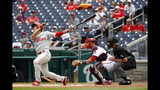 Philadelphia Phillies' Scott Kingery watches his solo home run in front of Washington Nationals catcher Yan Gomes and umpire Paul Nauert in the first inning of the first baseball game of a doubleheader, Wednesday, June 19, 2019, in Washington. (AP Photo/Patrick Semansky)