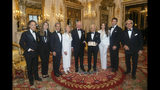The Prince of Wales, center, presents designer Ralph Lauren, fourth right, with his honorary KBE (Knight Commander of the Order of the British Empire) for Services to Fashion in a private ceremony at Buckingham Palace Wednesday June 19, 2019. (Victoria Jones/PA via AP)