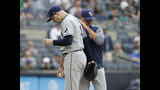 Tampa Bay Rays manager Kevin Cash, right, pulls starting pitcher Blake Snell from the game during the first inning of a baseball game against the New York Yankees at Yankee Stadium, Wednesday, June 19, 2019, in New York. (AP Photo/Seth Wenig)