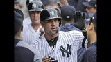 New York Yankees' Gary Sanchez celebrates with teammates after hitting a three-run homer during the first inning of a baseball game against the Tampa Bay Rays at Yankee Stadium, Wednesday, June 19, 2019, in New York. (AP Photo/Seth Wenig)