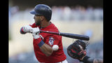 Minnesota Twins' Eddie Rosario swings for a strike against the Boston Red Sox during the first inning of a baseball game Tuesday, June 18, 2019, in Minneapolis. (AP Photo/Stacy Bengs)