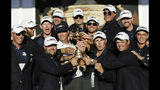 FILE - In this Oct. 2, 2016, file photo, United States captain Davis Love III, center left, is surrounded by his players as they pose for a picture during the closing ceremony of the Ryder Cup golf tournament at Hazeltine National Golf Club in Chaska, Minn. Hazeltine has a recent history of shockers, whether it was Rich Beem or Y.E. Yang winning the PGA Championship or the Americans winning the Ryder Cup. Now it hosts the Women's PGA Championship, a major that is rising to the top with the courses it plays. (AP Photo/David J. Phillip, File)