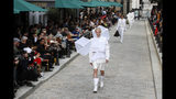 A model wears a creation for the Vuitton mens Spring-Summer 2020 fashion collection presented in Paris, Thursday, June 20, 2019. (AP Photo/Francois Mori)