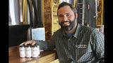 This June 14, 2019, photo shows Jake Wade, the owner and operator of Bearpaw River Brewing Co., posing for a photo in his craft brewery in Wasilla, Alaska. The brewery has begun making the Valley Trash ale, using the original recipe from another brewery that went out of business. The name of the beer harkens back to a slur cast on residents of the Matanuska-Susitna Borough by former state Sen. Ben Stevens, an Anchorage Republican who now serves as an aide to Alaska Gov. Mike Dunleavy. (AP Photo/Mark Thiessen)