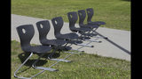 This June 14, 2019, photo shows a bank of chairs outside Wasilla Middle School that officials with Alaska Gov. Mike Dunleavy's administration said would accommodate adults if a special session were held in Wasilla, Alaska. Dunleavy has called lawmakers into special session in Wasilla beginning July 8, but some lawmakers have expressed concerns over security and logistics with the location more than 500 miles from the state capital of Juneau, Alaska. (AP Photo/Mark Thiessen)
