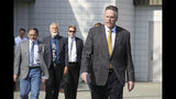 This June 14, 2019, photo shows Alaska Gov. Mike Dunleavy leading state and local officials out of Wasilla Middle School in Wasilla, Alaska, to a news conference. Dunleavy has called lawmakers into special session in Wasilla beginning July 8, but some lawmakers have expressed concerns over security and logistics with the location more than 500 miles from the state capital of Juneau, Alaska. (AP Photo/Mark Thiessen)