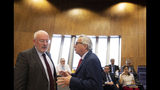 European Commission President Jean-Claude Juncker, right, speaks with European Commission Vice-President Frans Timmermans during a weekly meeting of EU commissioners at EU headquarters in Brussels, Tuesday, June 18, 2019. (AP Photo/Virginia Mayo)