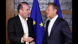 European People's Party member and Candidate for the next president of the European Commission, Germany's Manfred Weber, left, speaks with European Council President Donald Tusk ahead to a meeting on EU top jobs at the Europa building in Brussels, Thursday, June 13, 2019. (Olivier Hoslet, Pool Photo via AP)