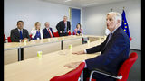 European Union chief Brexit negotiator Michel Barnier, right, meets with Irish Prime Minister Leo Varadkar , left, on the sidelines of an EU summit in Brussels, Thursday, June 20, 2019. European Union leaders meet in Brussels for a two-day summit to begin the process of finalizing candidates for the bloc's top jobs. (AP Photo/Olivier Matthys, Pool)