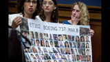 Deveney Williams, right, wipes a tear from her eye as she and Diana Sotomayor, left, and Hayley Freedman, center, all friends of Samya Rose Stumo, hold up a sign depicting those lost in Ethiopian Airlines Flight 302 during a House Committee on Transportation and Infrastructure hearing on the status of the Boeing 737 MAX on Capitol Hill in Washington, Wednesday, June 19, 2019. Stumo was killed in the plane crash. (AP Photo/Andrew Harnik)