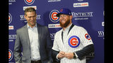 FILE - In this June 7, 2019, file photo, Chicago Cubs President Theo Epstein, left, introduces pitcher Craig Kimbrel during a news conference at Wrigley Field in Chicago. New Cubs closer Craig Kimbrel is at Triple-A Iowa, preparing to join the Cubs as they shoot for the N.L. Central crown.(Jose M. Osorio/Chicago Tribune via AP, File)