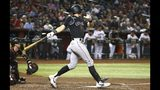 El jugador de los Rockies de Colorado Ryan McMahon sacude un doble de dos carreras en el séptimo inning del juego de la MLB que enfrentó a su equipo con los Diamondbacks de Arizona, el 19 de junio de 2019, en Phoenix. (AP Foto/Ross D. Franklin)