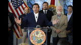 Florida Gov. Ron DeSantis speaks after signing a red tide mitigation and technology development initiative into law during a news conference at Mote Marine Laboratory Thursday, June 20, 2019, in Sarasota, Fla. DeSantis says Florida will commit $3 million for the next five years for the purpose of prioritizing red tide prevention. (AP Photo/Chris O'Meara)