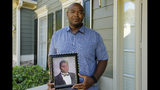 In this Friday, June 14, 2019 photo, Chris Parks poses with a portrait of his brother Donovan Corey Parks in Powder Springs, Ga. Marion Wilson Jr. and Robert Earl Butts Jr. were convicted of murder and sentenced to death in the March 1996 killing of 24-year-old Donovan Corey Parks. Butts was executed in May 2018. Wilson, who's 42, is set for execution Thursday, June 20. (AP Photo/Andrea Smith)